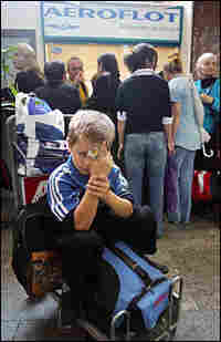 A boy waits to board a plane to Russia from the Tbilisi airport in October 2006.