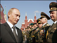 Russian President Vladimir Putin speaks with officers during a military parade in Moscow's Red Square, May 9, 2006. Putin led an elaborate ceremony marking victory in World War II and showcasing Moscow's new wealth.