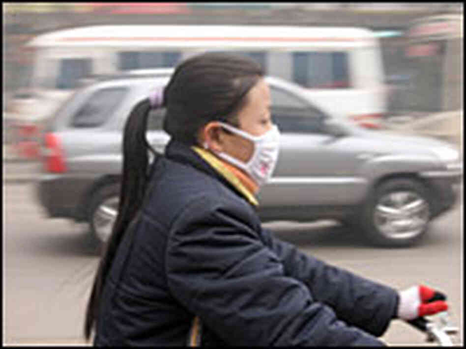 Residents of Linfen in Shanxi province wear face masks to protect themselves from the air they breat
