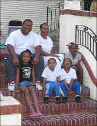 Parker Family Sits on Steps of Their Broadmoor Home
