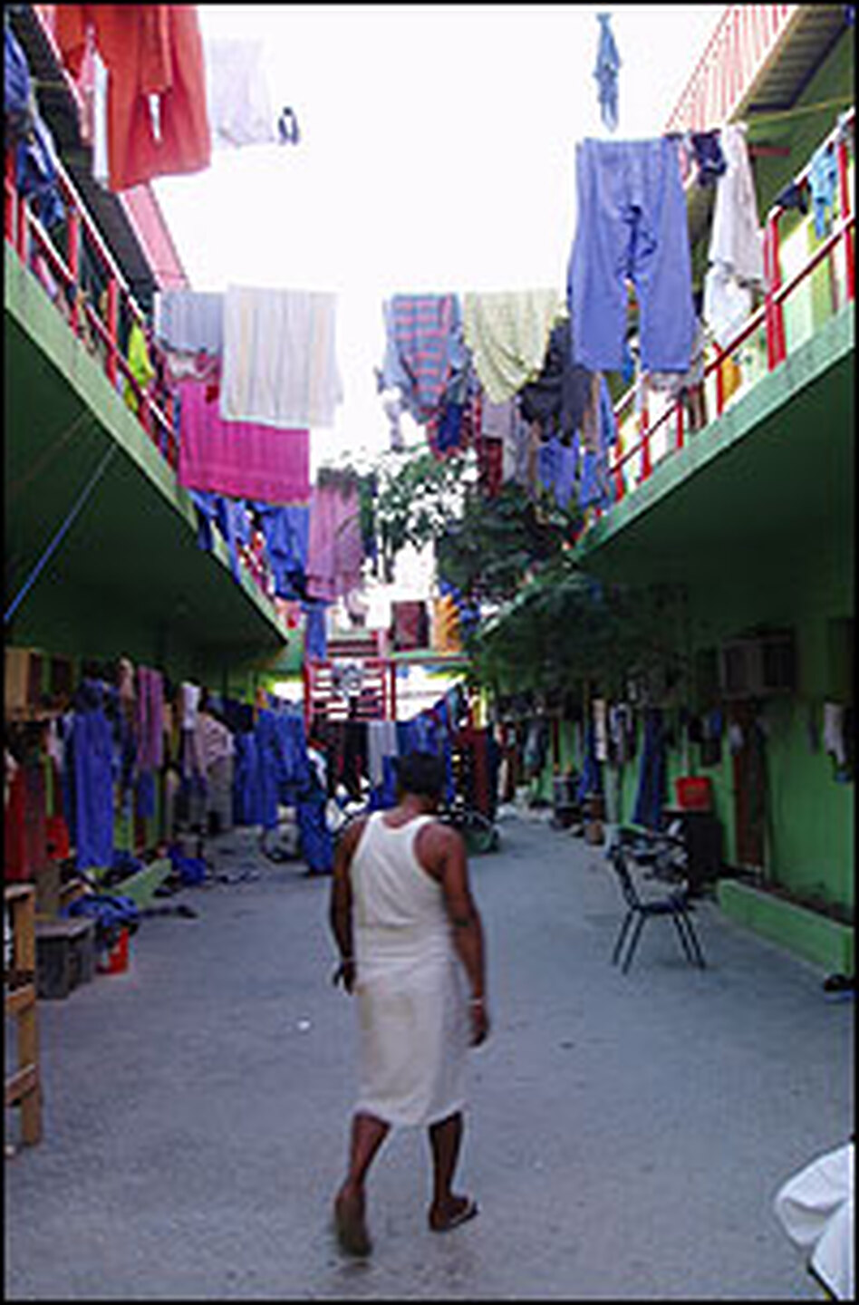 Blue uniforms hang to dry at one of the labor camps in Dubai, a city in the United Arab Emirates. Because of their inability to form labor unions, foreign workers who make up 95 percent of the country's labor pool are vulnerable to exploitation, according to Human Rights Watch.