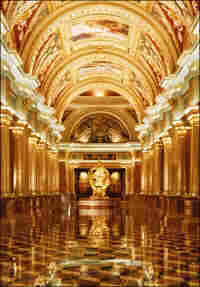 The ornate Italianate colonnade inside the Venetian Macau's entrance.