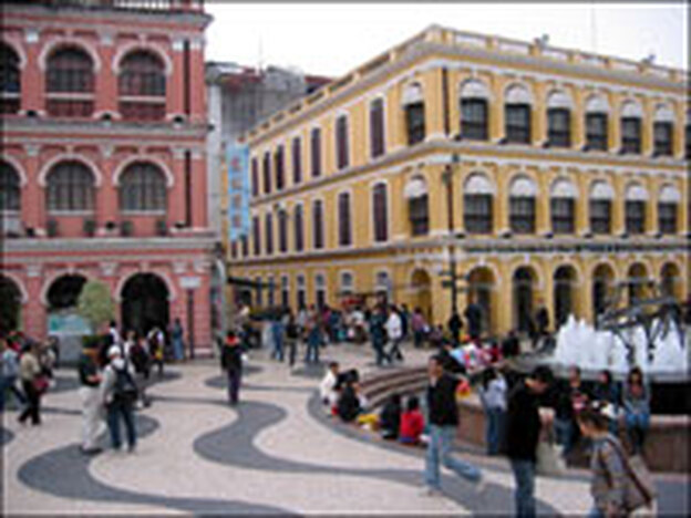Pedestrians walk through Senado Square in the heart of Macau's historical district.