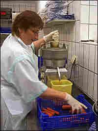 Gabriele Kutschke, a kitchen assistant at Buchinger, makes fresh fruit juice.