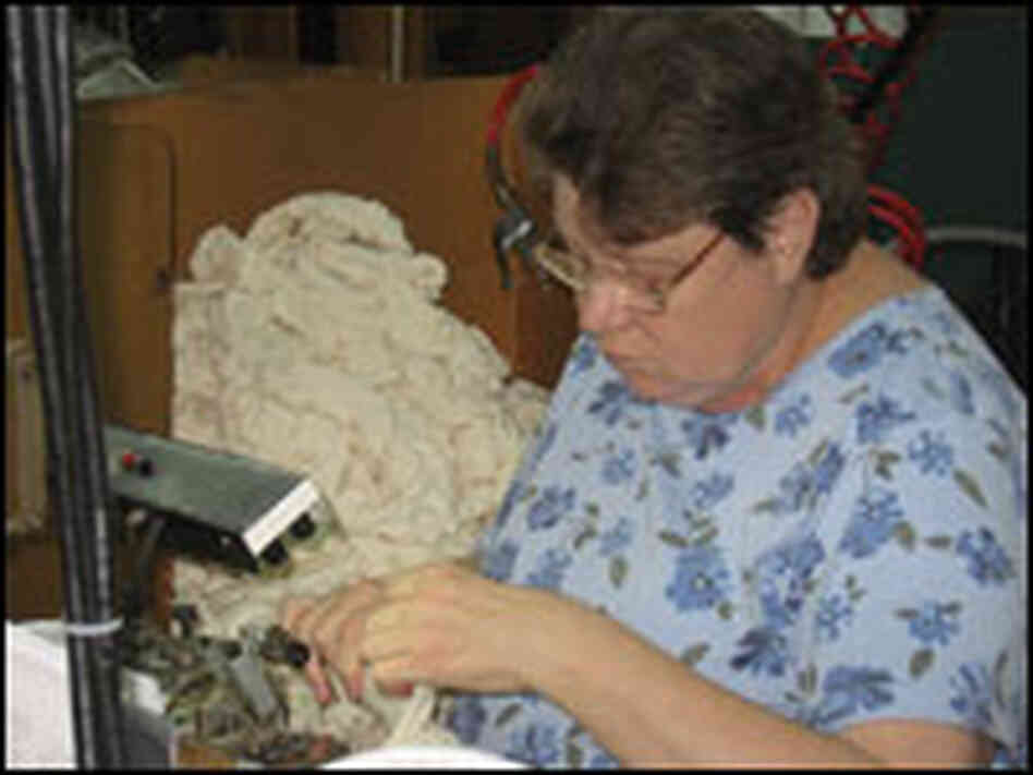 Worker seaming socks in Fort Payne, Ala.