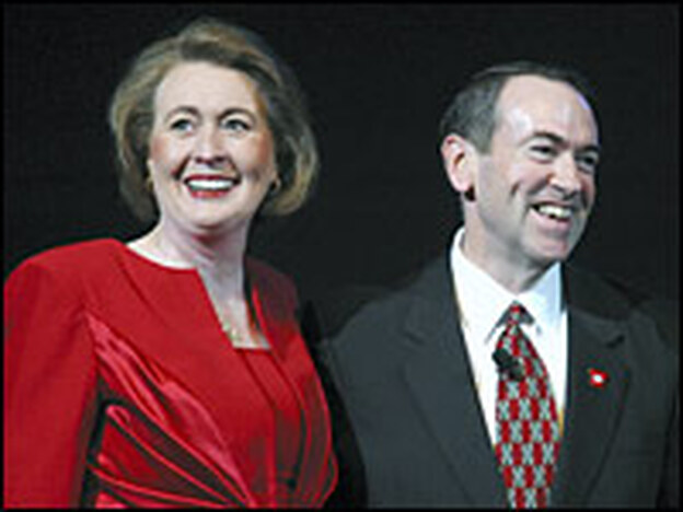 Arkansas Gov. Mike Huckabee and his wife, Janet, smile at a Valentine's Day gathering in Little Rock, Ark., Feb. 14, 2007.