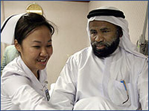 A Thai nurse takes care of a patient at Thailand's Bumrungrad hospital.
