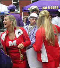 """Ole Miss cheerleaders rub elbows with LSU fans the """"Tiger Pimps"""" at the Grove prior to the big game."""
