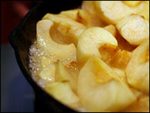 Apples cooking in a cast iron skillet
