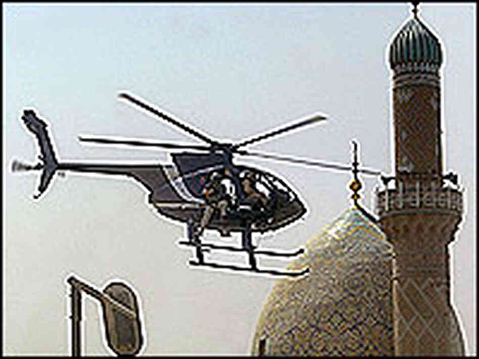 A blackwater helicopter flying over Baghdad