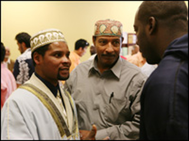 Imam Sheikh Rashid Lamptey greets members of his congregation following Friday prayers earlier this summer.