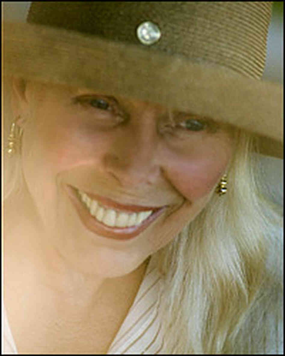 Joni Mitchell with hat.