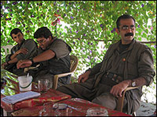 Iranian Kurdish rebels relax in the shade of the Qandil Mountains.  Commander Beryar Gabar (right) said the 2,000 militants in his faction are fighting to create a secular democracy in Iran.