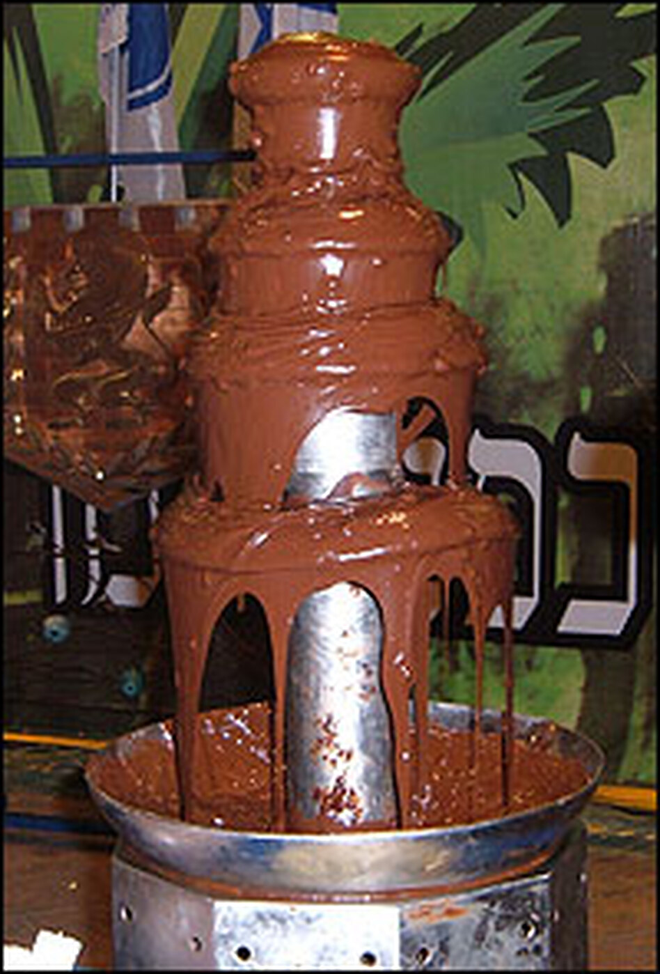 At this fountain of cascading chocolate, kids can get chocolate-covered marshmallows.