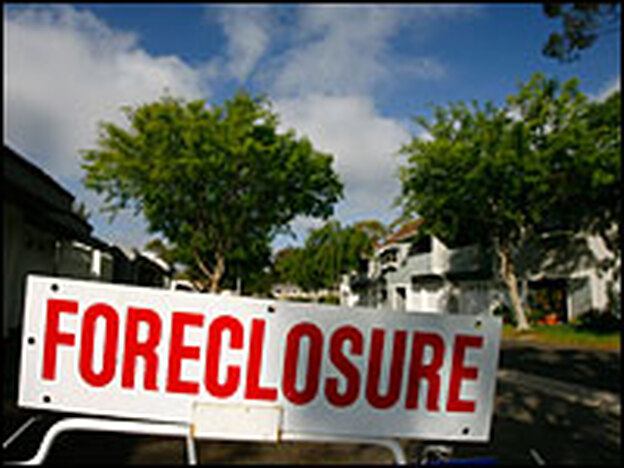 A foreclosure sign stands in the yard of a house in Southern California.