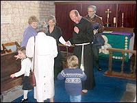 Martin Palmer greets parishoners