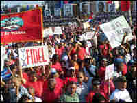 Cuban workers participate in the May Day parade in Havana on Thursday.