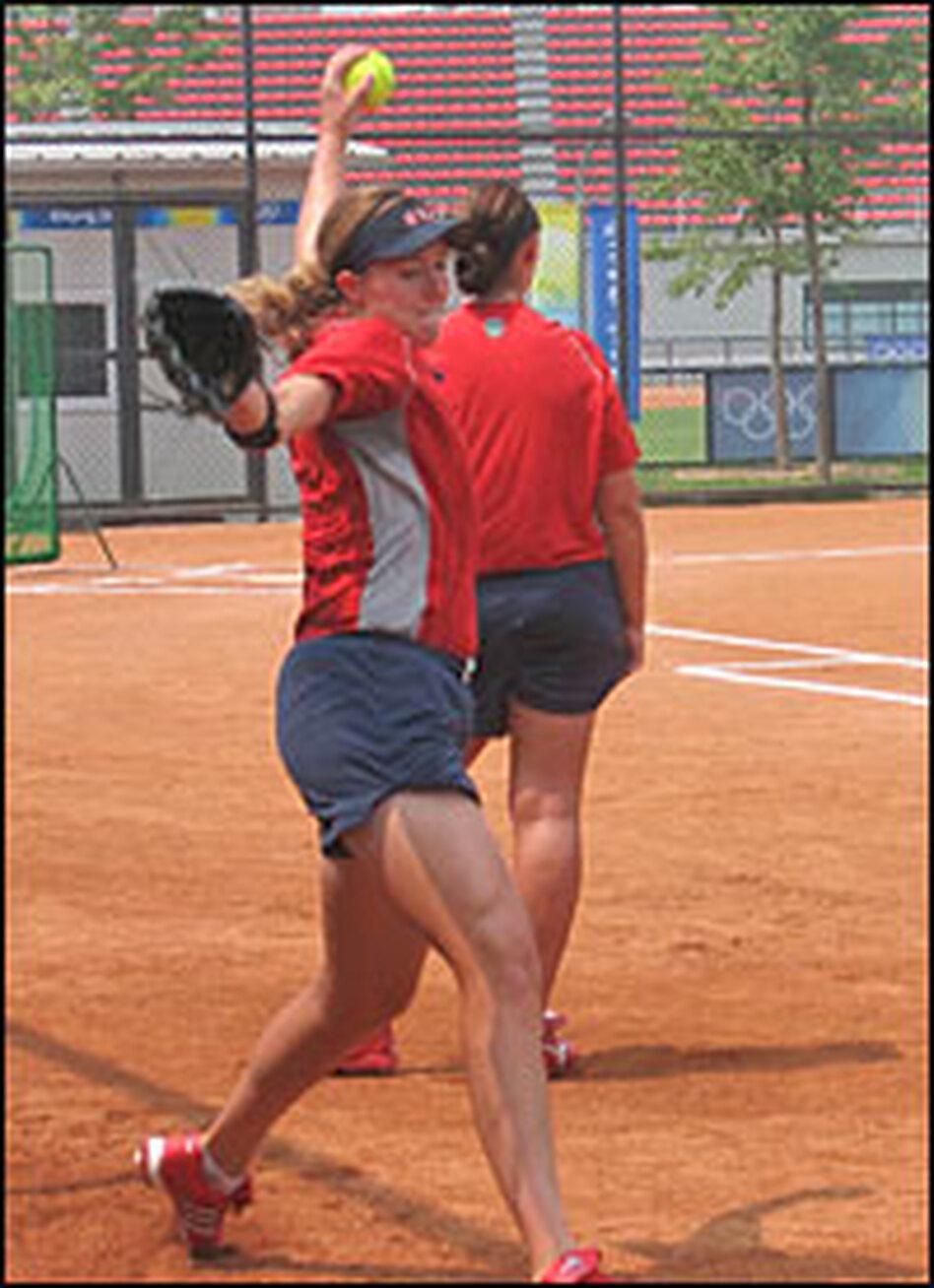 U.S. pitcher Monica Abbott throws a softball during practice.  Speeds can reach between 65 and 70 mph.
