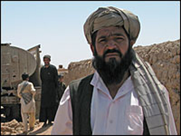 Abdul Abdul Rashid stands in front of a tanker bringing badly needed water to his drought-ridden village. The tanker was destroyed in the U.S.-Afghan operation.
