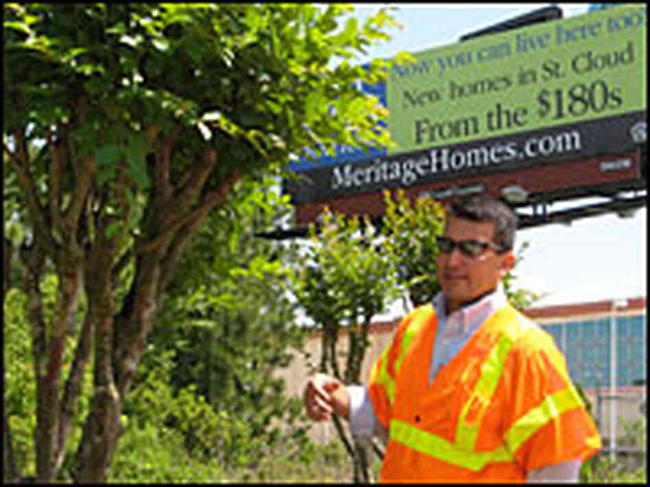Hector Lizasuain tends to the trees along U.S. Highway 192 in Osceola County Fla.