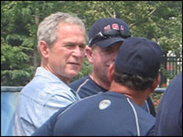President George W. Bush visits the U.S. softball team and talks with coaches at a practice at the Fengtai softball venue in Beijing.