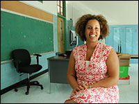 Channa Cook, principal of Sojourner Truth Academy, sits in a classroom at her school.