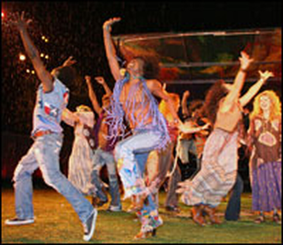 The <em>Hair</em> cast takes a curtain call on opening night at the outdoor Delacorte Theater.