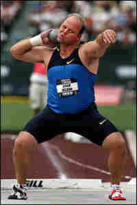 Shot-putter Adam Nelson competes during the Olympic trials in June