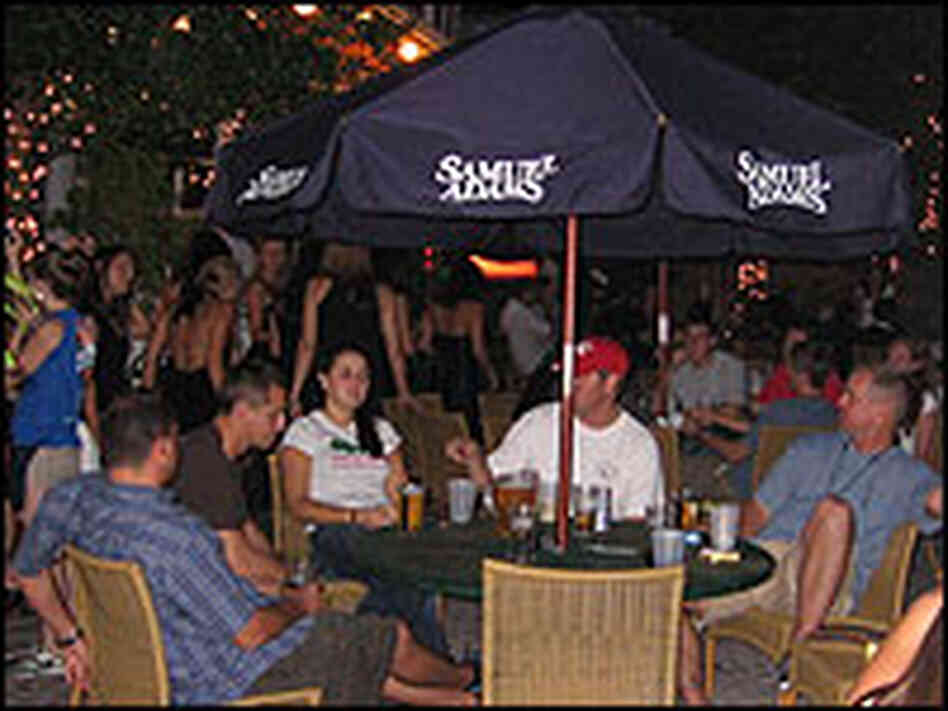 Students at a popular off-campus bar gather after a day of classes.