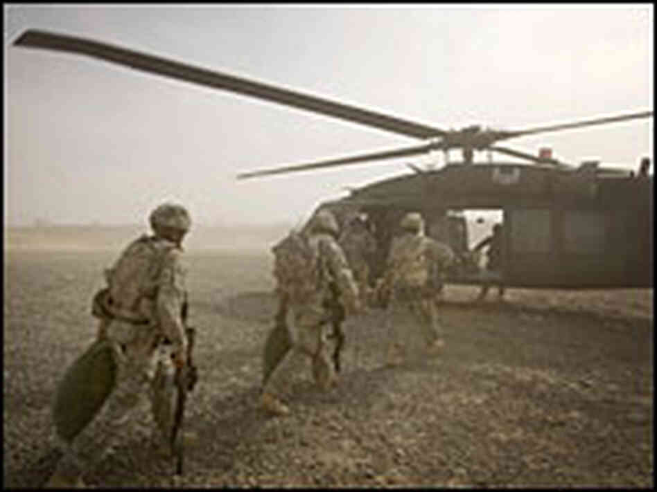Troops load into a Black Hawk helicopter
