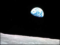 The Apollo 8 iconic image of the Earth rising over the moon's horizon.