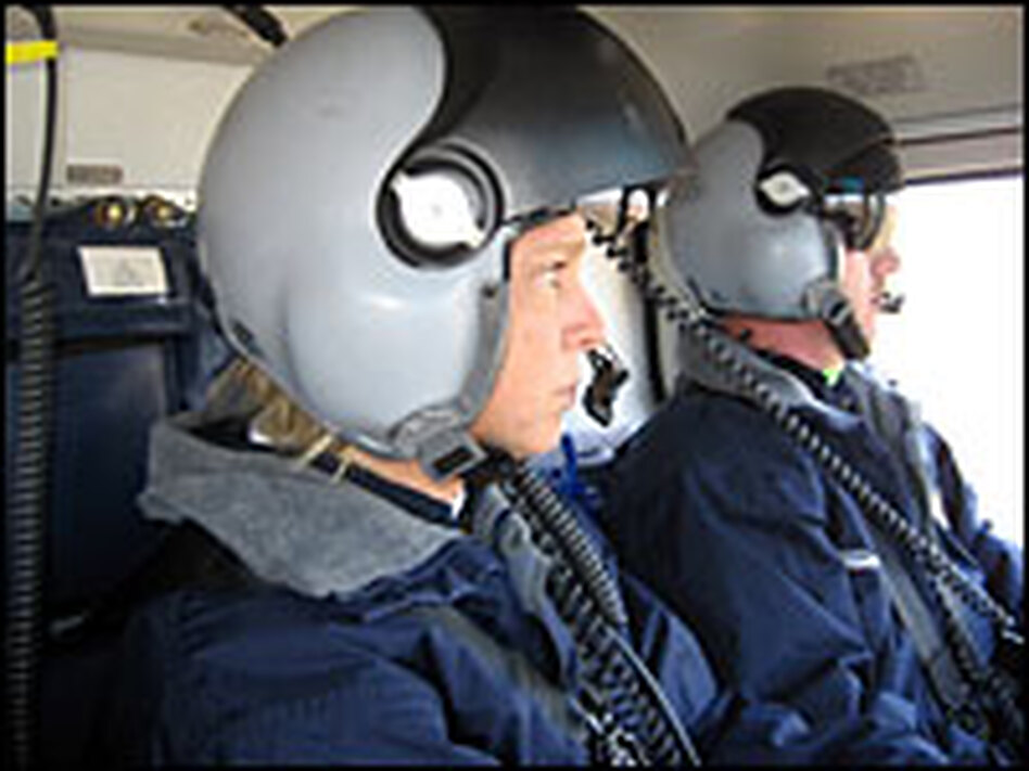 Nurse Rhonda Bailey (left) and flight paramedic Stacy Johnson watch for other aircraft and obstacles on a recent training flight. They work for Air Methods Huntsville MedFlight.