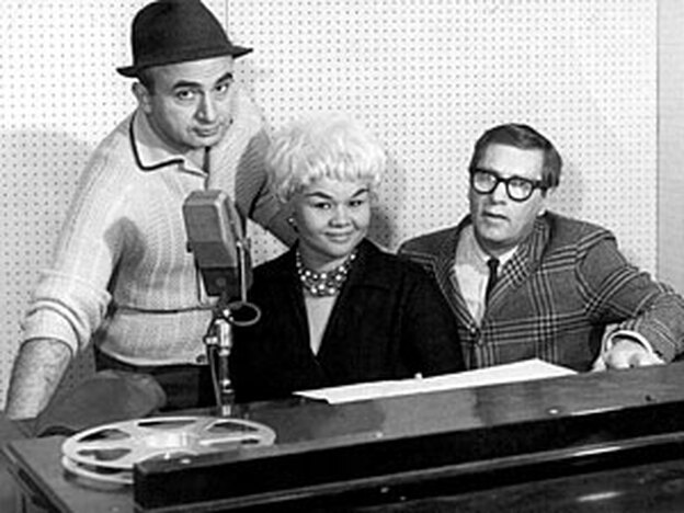 Etta James at the piano, with Chess Records co-founder Phil Chess (left) and producer Ralph Bass.