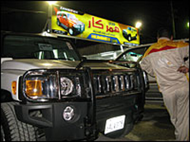 Hummers are on display at Safa Selmen Menjed's car dealership in an upscale Baghdad neighborhood.