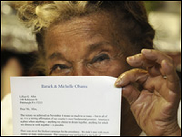 Allen shows off her thank-you letter from Barack and Michelle Obama for her work on his campaign.