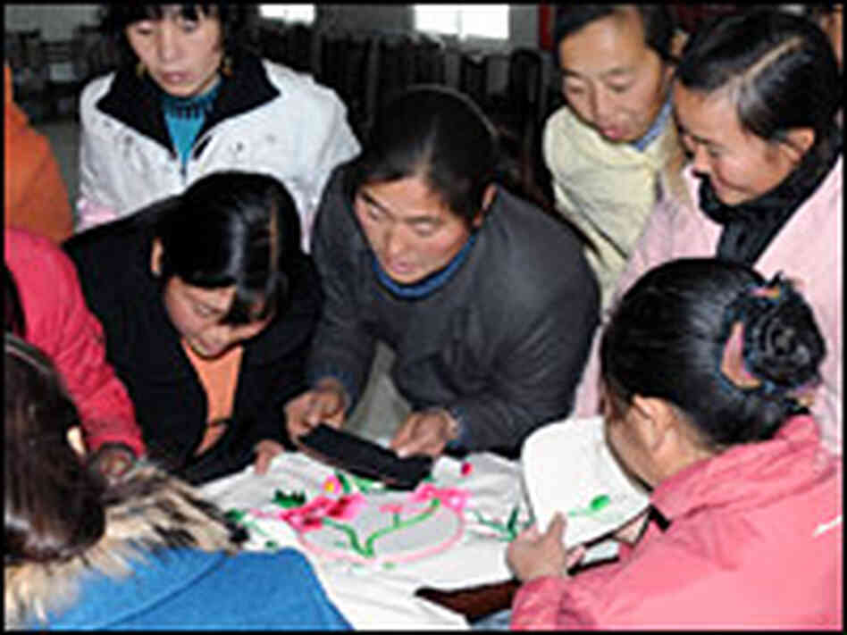 Women at the Leigu refugee camp in Sichuan province learn Qiang embroidery.
