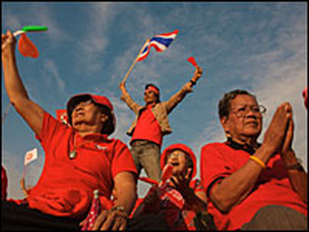 Pro-government demonstrators gather outside city hall in Bangkok on Sunday to support Prime Minister Somchai Wongsawat.