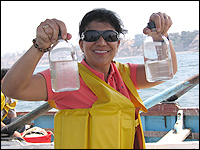 Researcher holding jars of water