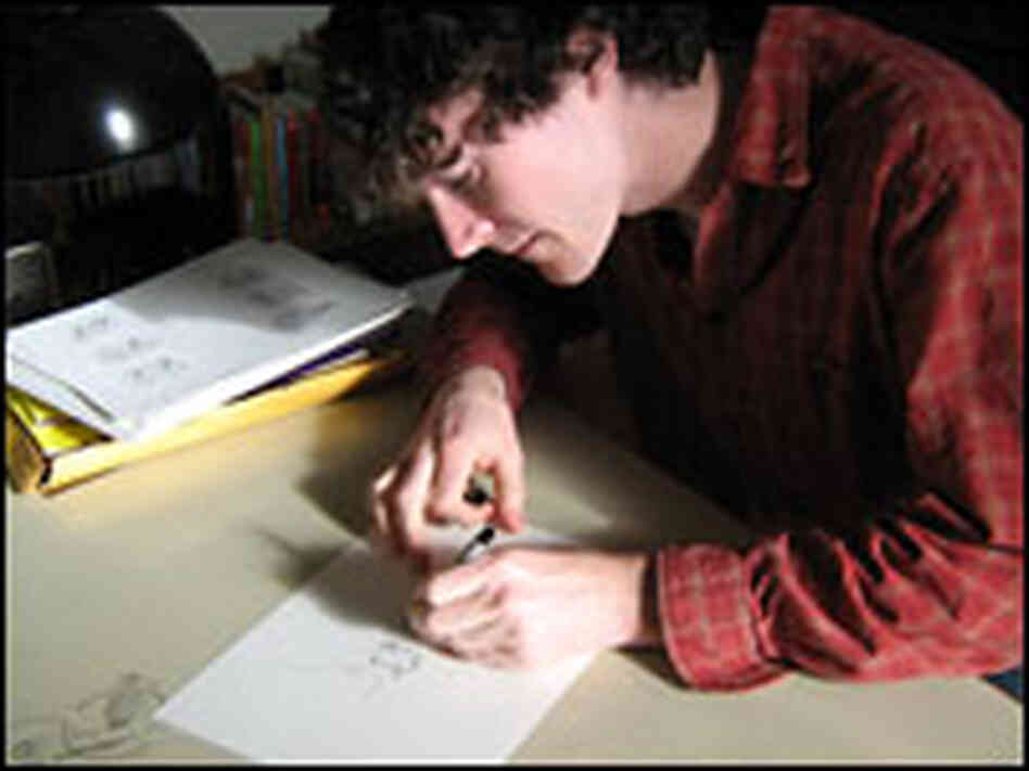 Max Eaton draws illustrations in his studio.