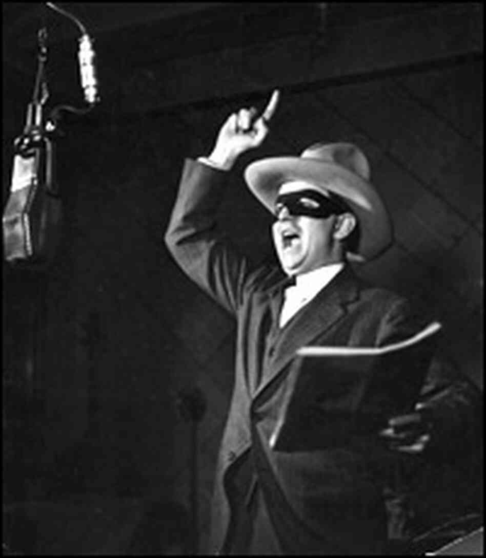 Earl Grasser as the Lone Ranger in the radio studio