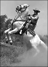 Clayton Moore as the Lone Ranger astride Silver
