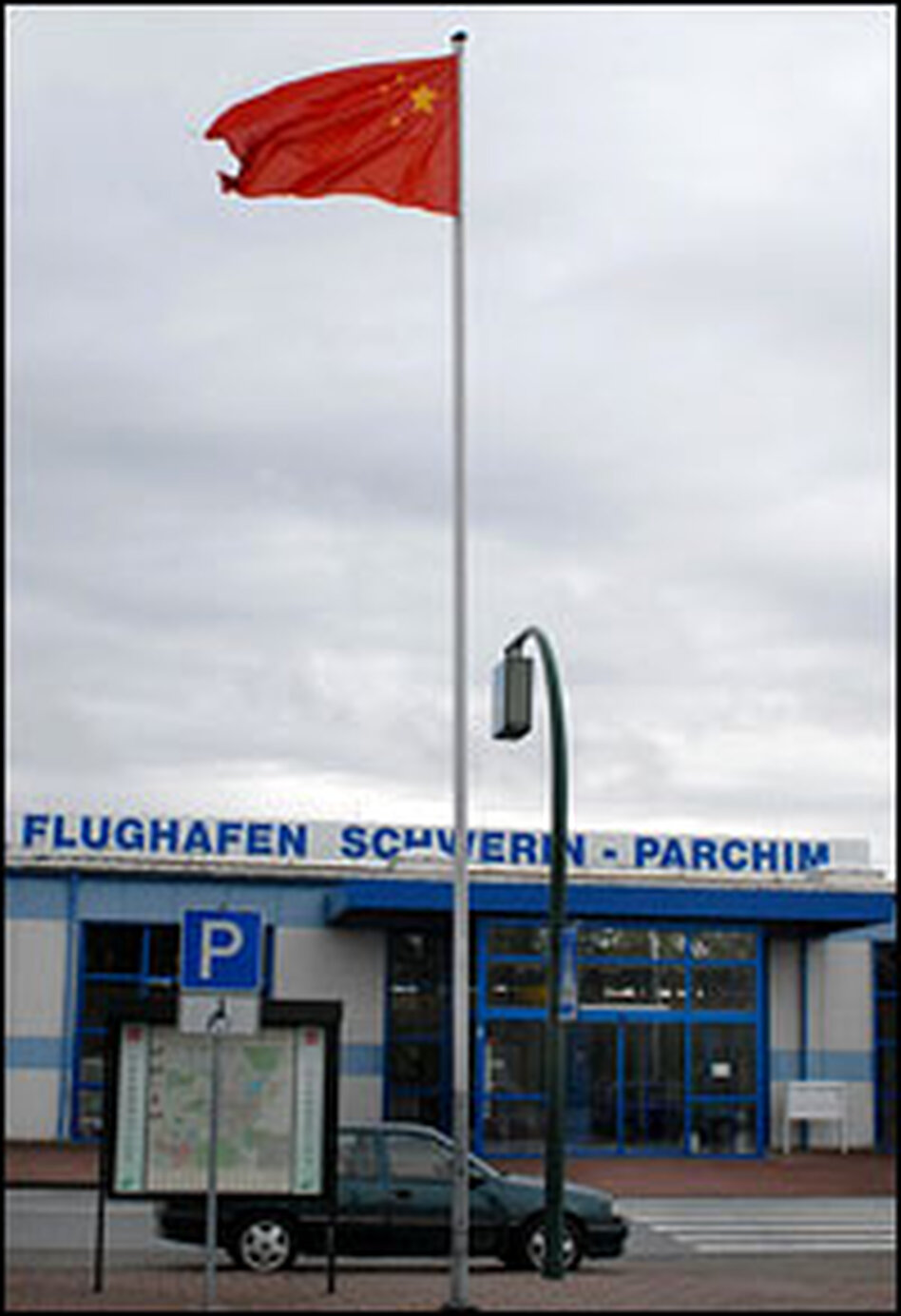 A Chinese flag flies above the terminal of eastern Germany's Parchim International Airport in honor of its new owners, a Chinese firm called LinkGlobal Logistics.