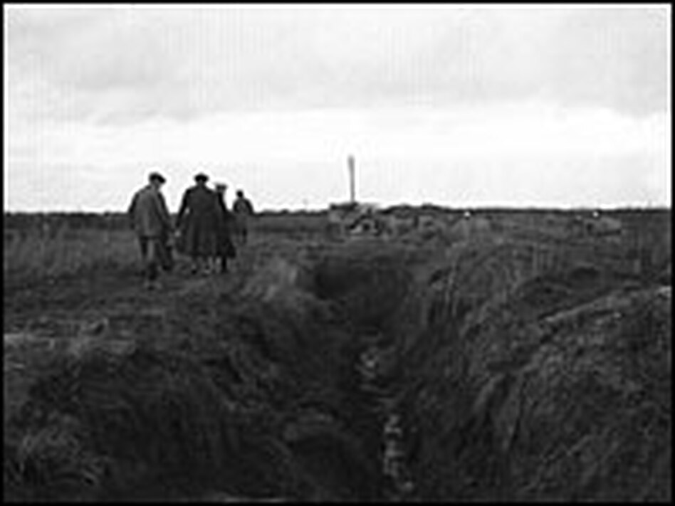 A group of men examine a section of the Hindenburg line, a series of trenches in northern France, in this photo from September 1919.