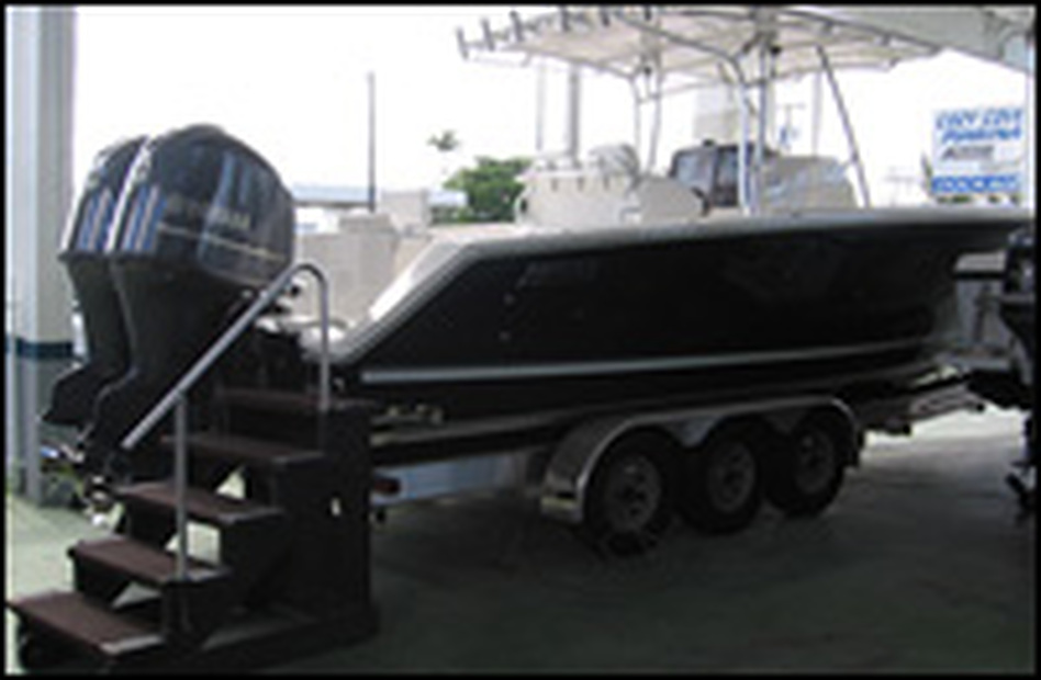 At Cozy Cove Marina near Fort Lauderdale, Fla., brokers say they're still selling expensive models to wealthy customers, who use them to fish and to tow behind their yachts.