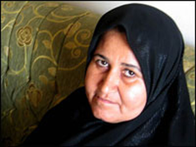 Ekhlas Mohammad Ali says her husband was told to divorce her or he would be killed. She is Shiite, and he is Sunni.