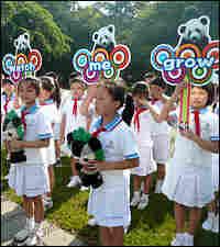 Schoolchildren participate in the launch of the 'Panda: Watch Me Grow' book.
