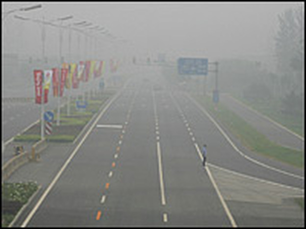 Smog shrouded a road to an Olympic venue in Beijing, China, on July 27, 2008. Pollution levels in Beijing topped the scale that day, just 12 days before the Olympics.