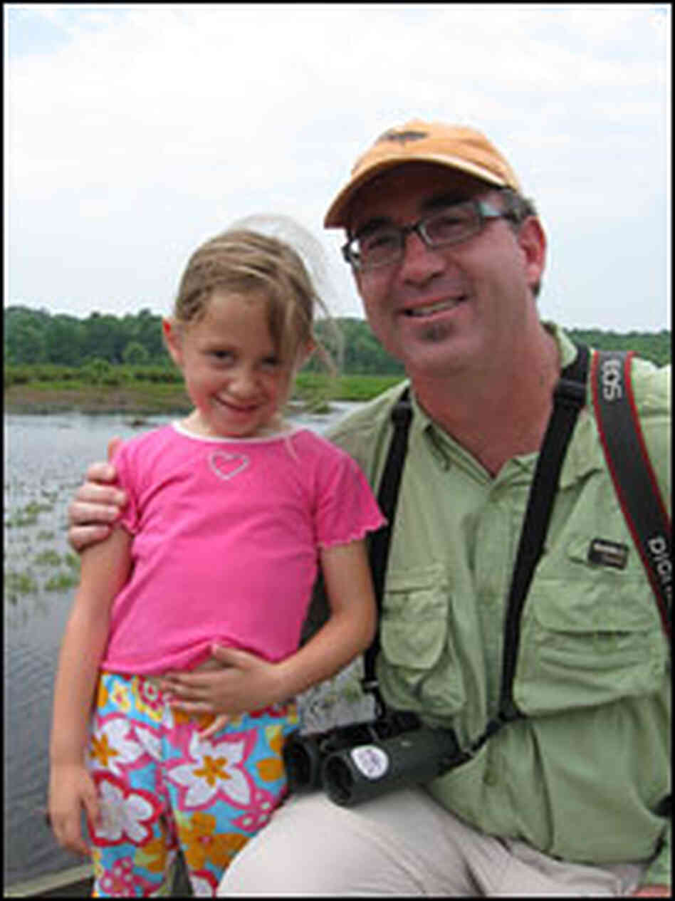 Author Bill Thompson III poses with Melissa Block's daughter, Chloe.