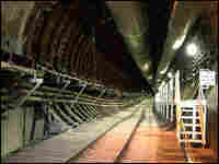 A rail tunnel descends into the Yucca Mountain waste repository.