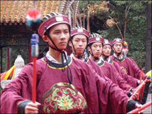 Attendants hold ritual implements at a celebration marking Confucius' 2558th birthday.
